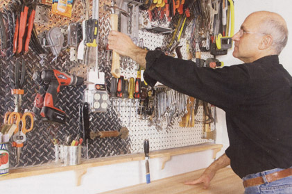 Hanging tools on metal pegboard
